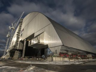 A gargantuan, arch-shaped, steel and concrete shelter is slowly being moved to cover the exploded Chernobyl nuclear reactor in Ukraine. The process, which will take several days, represents a significant step toward securing the site of the world's worst nuclear accident.